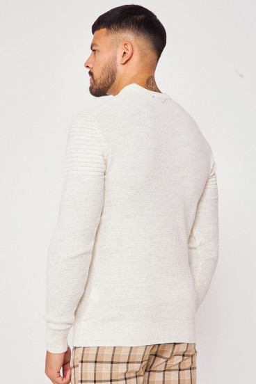 Pull beige col rond en maille à relief